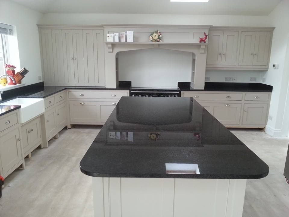 Traditional kitchen design with black granite