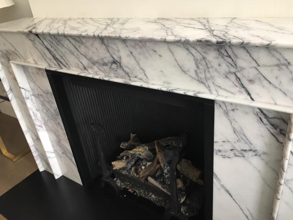 white and black granite fireplace