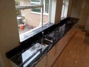 black and white marble patterned kitchen