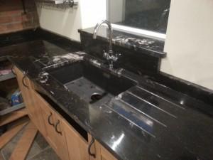 black quartz kitchen sink unit
