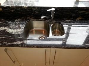 Dark marble sink unit