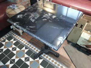 Black-granite-table-custom-made-for-rustic-pub