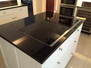 Black kitchen island with electric hob