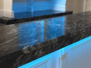 Dark-granite-counter-with-blue-neon-lights