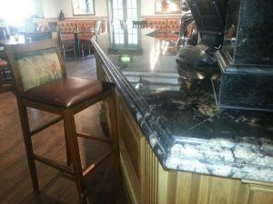Dark granite pub bar