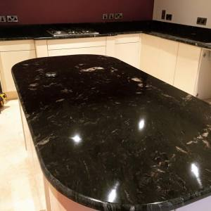 Rounded black granite kitchen island