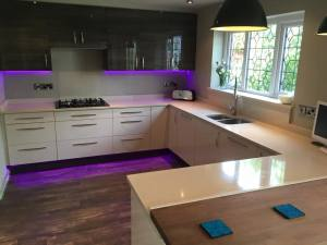 White kitchen counter purple lights