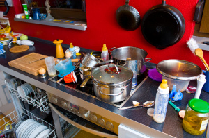 Cluttered out of date kitchen